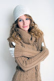 Winter cold is coming. Portrait of cheerful winter fashion girl warming up for the cold season Stock Photo