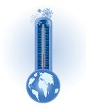 Winter cold concept. Thermometer with snowflakes at the top and globe below - Cold weather concept Royalty Free Stock Photography