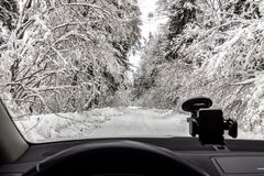 Winter cold day in the snowy forest from the car window. royalty free stock images