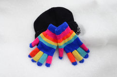 Winter colorful  Knit Gloves on  snow. Pic of  a Winter colorful  Knit Gloves Royalty Free Stock Photos