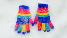 Winter colorful  Knit Gloves on a  snow. Pic of  a Winter colorful  Knit Gloves Stock Image