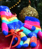 Winter colorful  Knit Gloves on a  snow. Pic of  a Winter colorful  Knit Gloves Stock Photo