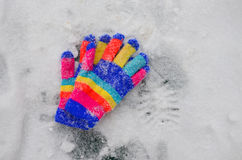 Winter colorful  Knit Gloves on a  snow Stock Photography