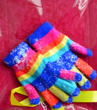 Winter colorful  Knit Gloves on a  snow. Pic of  a Winter colorful  Knit Gloves Royalty Free Stock Photo