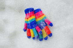 Winter colorful  Knit Gloves on a  snow. Pic of  a Winter colorful  Knit Gloves Royalty Free Stock Images
