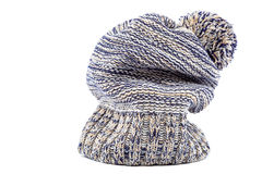 Winter colorful knitted cap on a white Stock Images