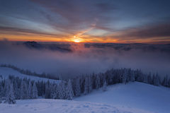 Winter colorful sunrise over the clouds Stock Photos