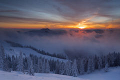 Winter colorful sunrise over the clouds Royalty Free Stock Photography
