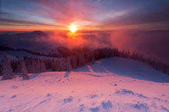 Winter colorful sunrise over the clouds Stock Images