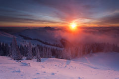 Winter colorful sunrise over the clouds Stock Image