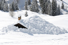 When the winter comes. Chalet under the snow in french alps in winter Royalty Free Stock Photo