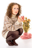 Winter comfort girl resting in a sweater with a cup of tea Stock Photo