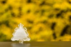 Winter is coming. Christmas tree ice decoration on autumn background Royalty Free Stock Image