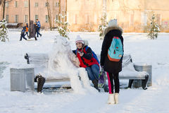 Winter is coming. Two girls doing selfie with a snowman Royalty Free Stock Photos