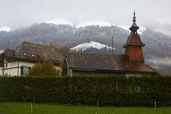 Winter is coming. A view of Dent de Broc and Dent du Chamois at the beginning of winter during snowing. The mountings are covering with snow while lowland is Stock Photos