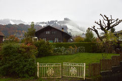 Winter is coming. A view of the hills near  La Maison du Gruyere at the beginning of winter during snowing. The mountings are covering with snow while lowland Royalty Free Stock Photography