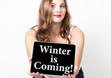Winter is coming written on virtual screen. technology, internet and networking concept. beautiful woman with bare Stock Photo