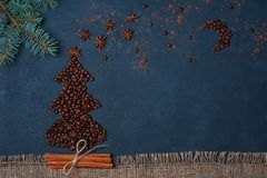 Winter composition Christmas tree made by coffee beans with night sky by anise star and chocolate. Greeting card New Year. Creativity concept. Background Royalty Free Stock Photography