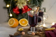Christmas red mulled wine in glass on wood board at white background stock image