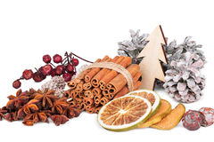 Winter composition with spices, slices of citrus fruits, p. Winter composition with spices, slices of dried citrus fruits, pine cones and star anise on white Royalty Free Stock Images