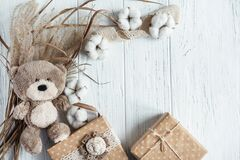 Free Winter Composition With Dry Plants, Gift Boxes And A Toy Bear On A Wooden Background. Template For A Greeting Card With Royalty Free Stock Image - 198654136