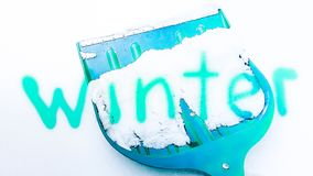 Winter concept. Blue shovel for snow removal with text Winter