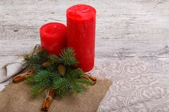Winter concept of a candle with a spruce royalty free stock images