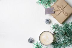 Winter Concept, Christmas Gift, Coffee Mug, Pine Cones and Braches, Cozy Still Life Background. Flat Lay, Top View royalty free stock photo