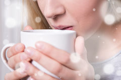 Winter concept - close up of woman drinking hot coffee or tea Royalty Free Stock Photos