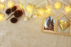 Winter concept with cozy lifestyle objects over fur carpet. Top view. Royalty Free Stock Images