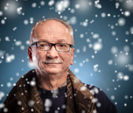 Winter concept -  elderly man looks skeptically Stock Photography