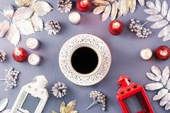 Winter concept flat lay with silver leaves, lantern, candles and hot coffee. Christmas frame background royalty free stock photo