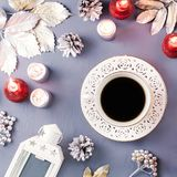 Winter concept flat lay with silver leaves, lantern, candles and hot coffee. Christmas frame background stock photo