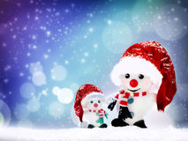 Winter concept with Snowman dressed in red scarf and hat Royalty Free Stock Photography