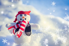 Winter concept with snowman on snow background. Royalty Free Stock Image