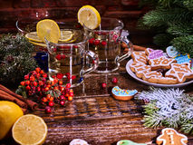 Winter cookies plate and punch glasses mug . Brick wall background. Stock Images