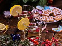 Winter cookies plate and two punch glasses mug with berries. Stock Image