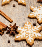 Winter Cookies. Snowflake shaped Gingerbread cookies with spices royalty free stock image