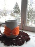 Winter cosiness: white ceramic mug of tea or coffee royalty free stock photography