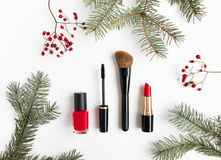 Winter cosmetics collage decorated with fir tree and berries on white background. Flat lay, top view. Winter cosmetics collage decorated with fir tree branches Stock Images