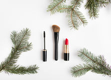 Winter cosmetics collage decorated with fir tree on white background. Flat lay, top view. Winter cosmetics collage decorated with fir tree branches on white Royalty Free Stock Image
