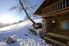 Winter cottage. Tree, snow and cottage in france. Typical lodging in the French alps in winter Stock Photos