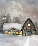 Winter cottage. Beautiful winter cottage in an enchanted winter scenery Stock Photography