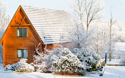Winter cottage Stock Images