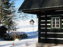 Winter cottage with cratch royalty free stock image
