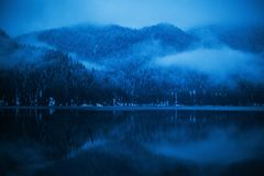 Winter Cottage on Ritsa Lake in the mountains of Abkhazia royalty free stock images
