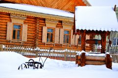 Winter cottage in the village Royalty Free Stock Photos