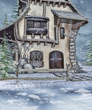 Winter cottage with a wooden fence Stock Images