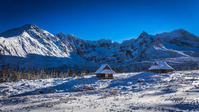 Winter cottages in the high mountains Royalty Free Stock Image