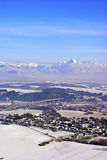 Winter country. With village and mountain range in background royalty free stock images